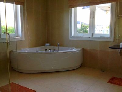 Masterbath with whirlpool tub and glass shower
