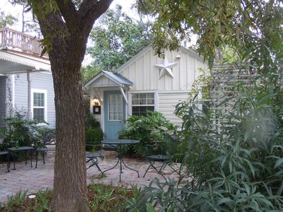 Carriage House Cottage nestled among towering pecan trees two blocks from  Main.