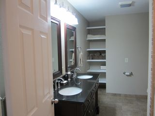 Vero Beach studio photo - Large bathroom with beautifully tiled shower and double sinks with closets
