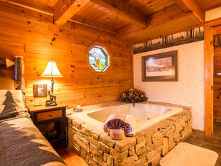 Pigeon Forge cabin photo - master bedroom jacuzzi area with attached bathroom