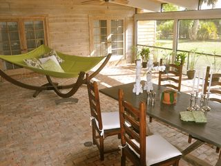 Wellington farmhouse photo - Screened outdoor dining and sitting area.
