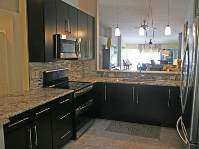 Brand new designer kitchen with all new appliance, cabinets, and granite !!!