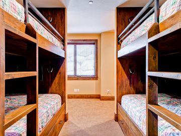 Lower level girl's bunk room - four queen beds with individual TV's