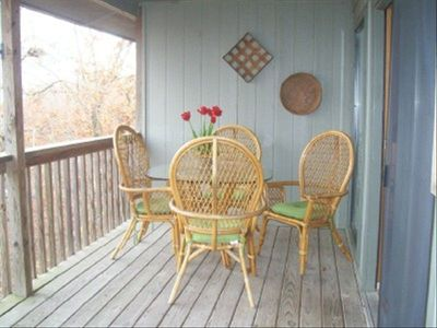 ranch One end of deck with 1 of 2 dining sets