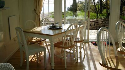 The dining table and chairs - overlooking the lake.