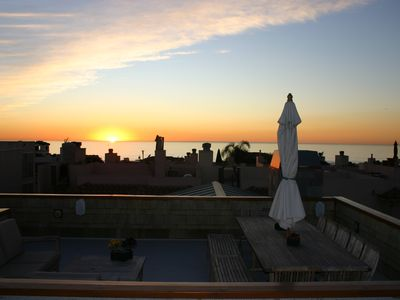 Hermosa Beach townhome rental - Gorgeous sunset off of roof deck - ocean view, table seats 14, firepit