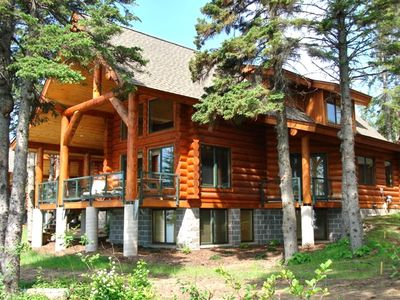 Lake front with large deck and tons of windows!
