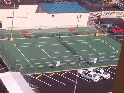 Tennis court with shuffle board court behind it