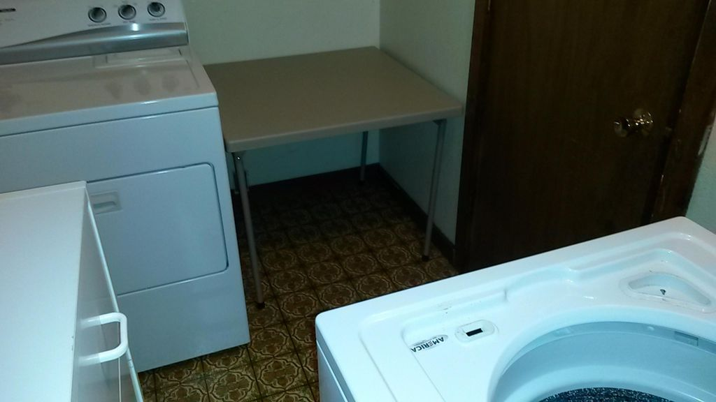 Laundry room with folding table.