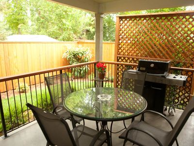 Cozy Private Covered Patio with private garden, gas grill, patio table and chair