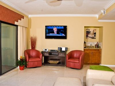 50 inch T.V, leather swivel chairs, wet bar.