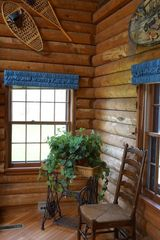 Minocqua cabin photo - Many quiet corners with tasteful furnishings amidst warm log decor