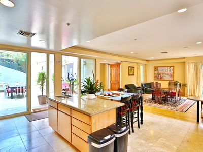 Kitchen opens to Dining Room and Large Outdoor Patio. Lots of Natural light!