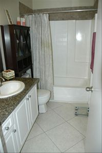 Updated bathroom with refinished shower/tub.