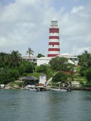 Elbow Cay and Hope Town villa photo - The famous candy striped lighthouse overlooking the picturesque settlement