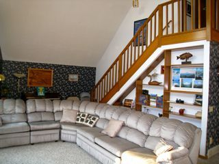 Spokane chalet rental - Coach with queen size hide a bed. Stairs to the loft