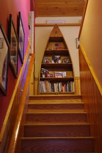Staircase leading to great room, kitchen, master suite, powder room and deck