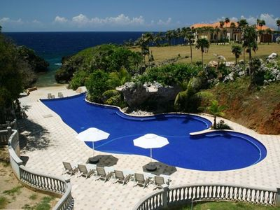 Pool with twin waterfalls, private beach to the open sea