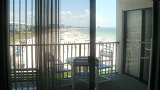 St Pete Beach condo photo - View from living room on a busy summer beach day.