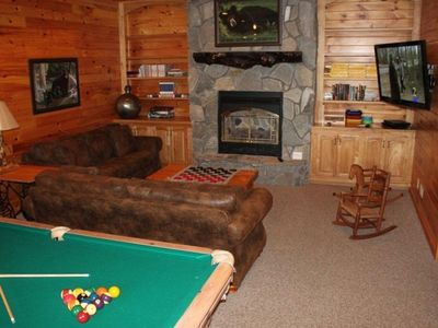 "Game room with pool table , wet bar,gas fireplace& 52"" flat screen TV"