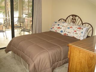 Lake Gaston house photo - Enjoy lake sunrises from 2 lakefront bedrooms
