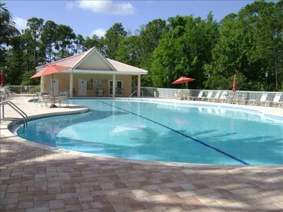 Large pool area features new pavers, new pool furniture and new umbrellas.