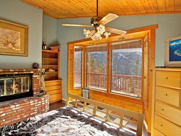 Moonridge cabin rental - Master Bedroom with fire place and Mtn view