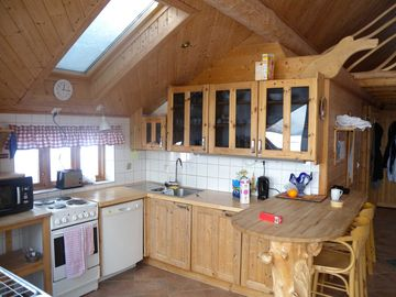 Big Cabin interior kitchen and breakfast bar