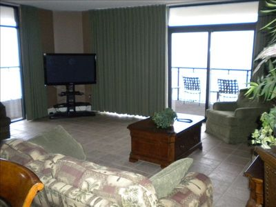 "South Wind condo rental - Living area with a HUGE 50"" HD flat screen TV and wrap around views."