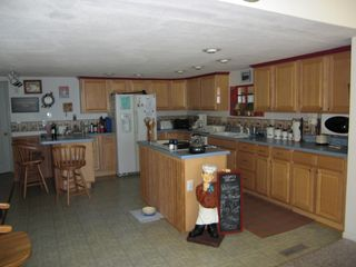 Goodview house photo - come back and into open kitchen