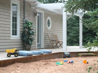 Stanley Bridge cottage photo - Entrance and massive play sand area. Sandbox does not do this area justice.