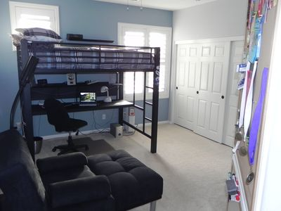 Full Sized Loft Bed with plenty of space for more on the floor.