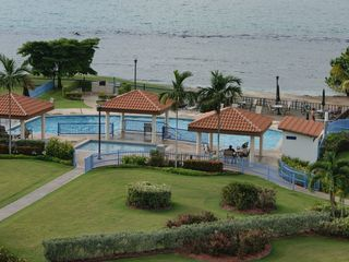 Cabo Rojo apartment photo - Pools area view. Ample deck with lots of lounge chairs. Gazebos w/seating area