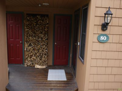 Entrance to the townhouse, complete with firewood.