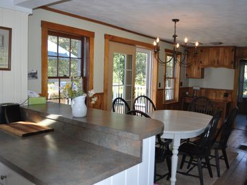kitchen toward dining area with doors to deck