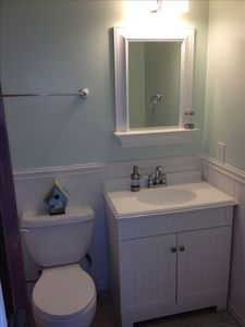 Hall bath with tub and tile surround