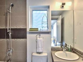 Seattle house photo - shower bar now installed. Modern and simple.