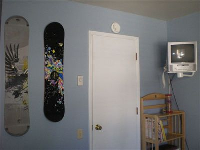 The 2nd bedroom is decked out in snowboard gear.