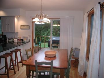 Dining Room and view of back deck and yard