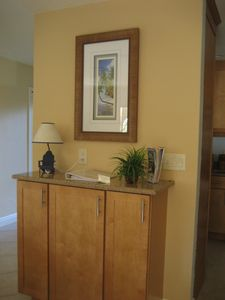 Sanibel Island condo rental - Game cabinet loaded with games and books for kids of all ages!