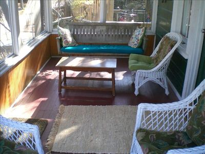 Front screened-in porch with swing