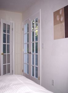 From Master Bedroom, Two Sets of French Doors, One to Outdoor Wood Balcony