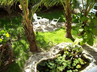 Great Exuma cottage photo - Tropical backyard garden for BBQ...