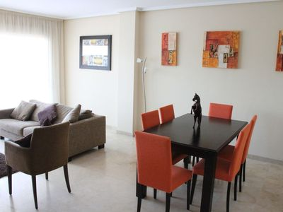 Marbella Town apartment rental - Indoor dining area and lounge area leading to balcony with al fresco dining