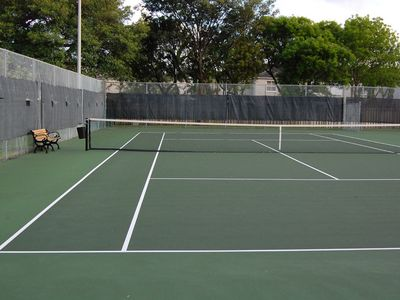 Two beautifully maintained lighted tennis courts that are rarely used