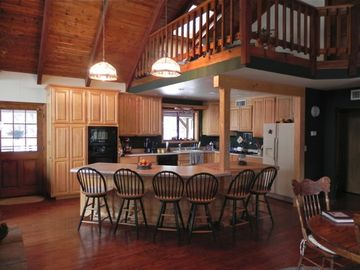The spacious kitchen with a large island. The loft is above the kitchen.