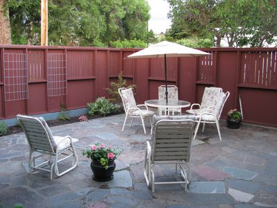 The garden patio with original flagstone and renovated '50s-style fence.