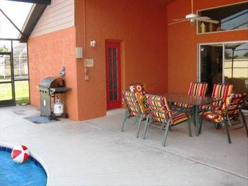 Screened and covered lanai, BBQ, lounge chairs and a big back yard.