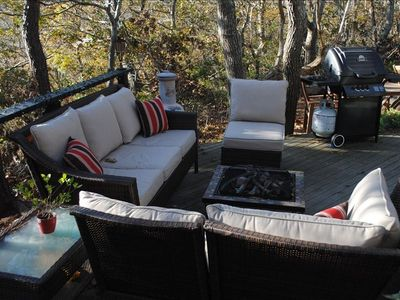 Outdoor deck with fire pit and grill
