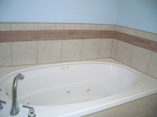 Kure Beach townhome photo - Jetted tub in the main master bedroom.
